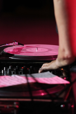 Vinyl records, equipment and hand. The red background photo