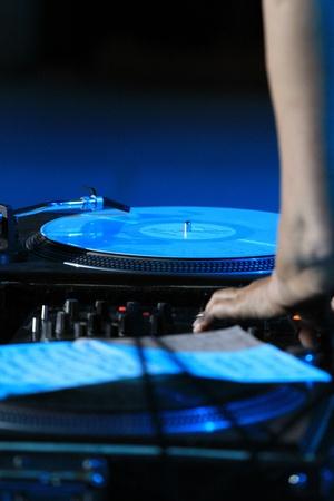 Hand DJ on professional equipment photo