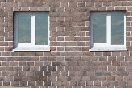 A wall of stone bricks with windows Stock Photo - 15380201