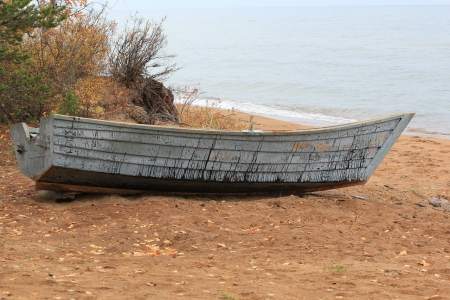 fishing scene: Old boat on the beach