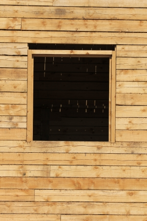 wooden wall with window opening photo