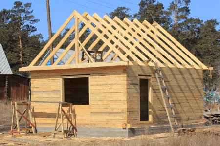 construction plans: construction of log houses Stock Photo
