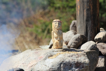 paganism: carved wooden pagan idol