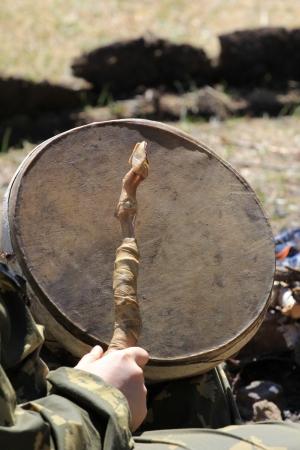 shaman plays the tambourine