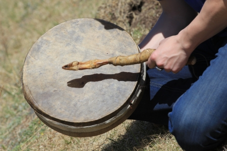 shaman plays the tambourine