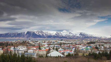 volcan: Icelands capital Reykjavik with volcanoes in the background. Stock Photo