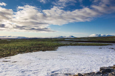 Icelandic landscape with snow and volcanoes Stock Photo
