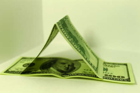 international crisis: Hundred dollar notes house