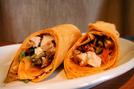 tortilla wrap: Tortilla wrap filled with chicken teriyaki Stock Photo