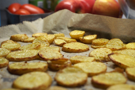 fried potatoes: Fried potatoes on a baking tray Stock Photo