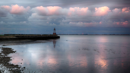 Old beacon at the Wadden Sea in Wilhelmshaven Stock Photo
