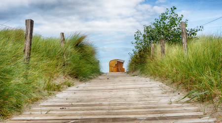 Dunes and a beach chair on the beach Stock fotó - 89451855