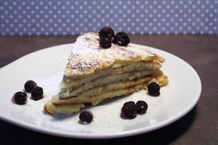 Pancakes with blueberries and sugar powder