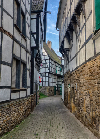 Half-timber house in a narrow road in Hattingen Stock Photo