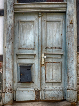 Old weathered door in a half-timbered house