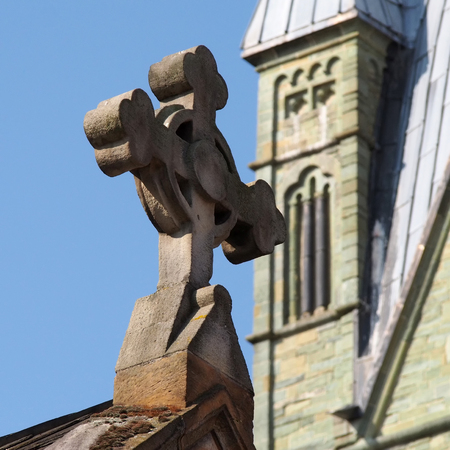 Stone cross on a church in Soest