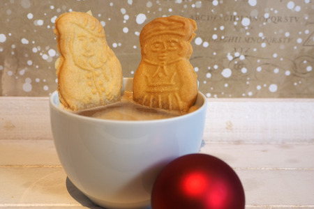 Christmas cookies relaxing in a coffee cup