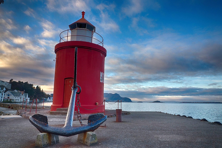 Lighthouse in the harbor of Alesund in Norway