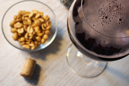 Black currant flavored beer and peanuts