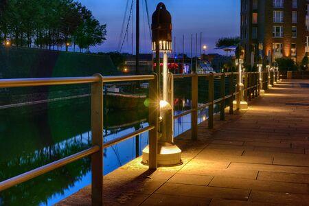 Illuminated promenade in the old town harbor of Duesseldorf
