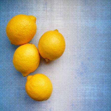 Fresh lemons on a blue background