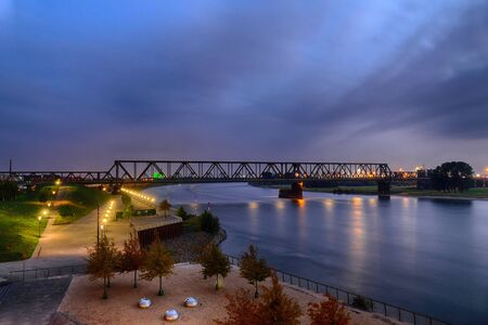 View at the river Rhine and a historical railway bridge in Duisburg Hochfeld 스톡 콘텐츠
