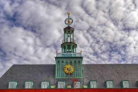 Tower and weather vane of the historical city hall in Emden in East Frisia