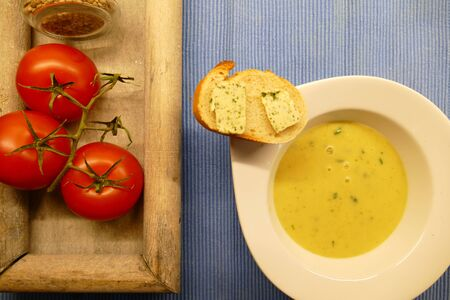 Leek cream soup with potatoes, bread and herbs butter