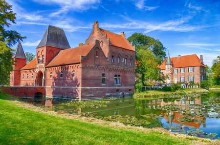 Historical rural moated castle in Westphalia 스톡 콘텐츠