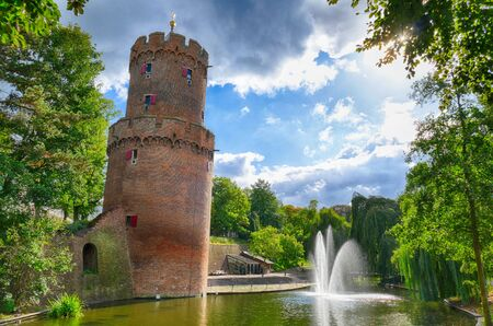 Pond and old tower in a public park in Nijmegen 스톡 콘텐츠