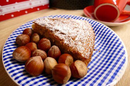 Hazelnut cake on a plate with hazelnuts 스톡 콘텐츠