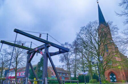 Historical drawbridge and church in Papenburg Archivio Fotografico