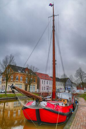 Historical binland ship on the main canal in Papenburg