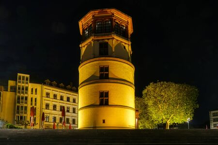 Illuminated tower by the Rhine in the historical center of Duesseldorf