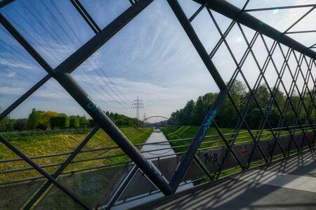 The river Emscher seen from a bridge in a park in Gelsenkirchen