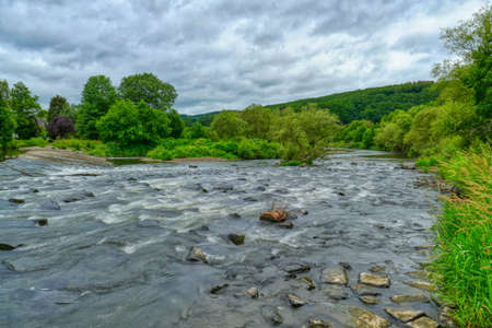 Rapids at the weir in the river Sieg near Dattenfeld Stok Fotoğraf