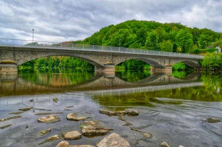 Bridge at the weir across river Sieg near Dattenfeld Stok Fotoğraf