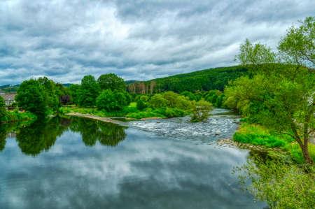 Bridge at the weir across river Sieg near Dattenfeld Stok Fotoğraf - 150880056