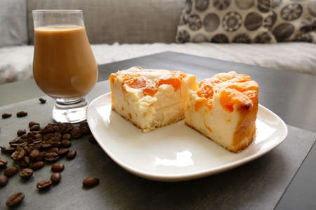 Mandarin sour cream cake with iced coffee Stok Fotoğraf - 152036037