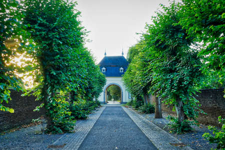 Historical gate and alley in Knechtsteden in Germany Stok Fotoğraf - 152102550