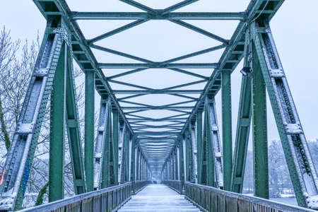 Historical bridge across the river Ruhr near Essen Kupferdreh in winter