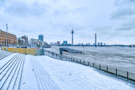 Rhine stairs with high water in Dusseldorf in winter
