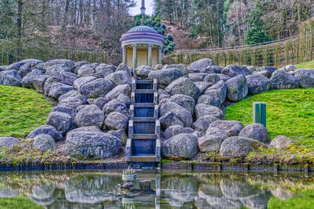 Temple and pond in a historical park in the Tiergarten zoo in Kleve