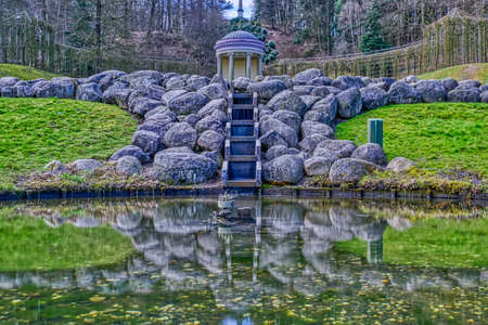 Pond and temple in a historical park in the Tiergarten zoo in Kleve Stok Fotoğraf