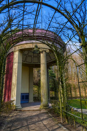 Archway towards a temple in a park at the Tiergarten zoo in Kleve