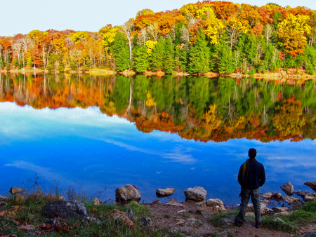Lake Logan Rose Lake in Fall at Hocking Hills State Park, Ohio The person in the photo is the artist himself, who took the photo by using a tripod and the camera s self timer