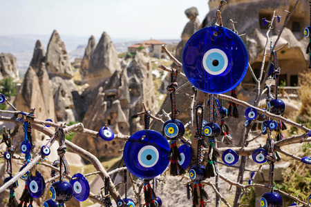 A tree decorated with non-commercial Evil Eyes at Cappadocia  Evil Eye is a Turkish traditional ornament dating back to Paganism  photo