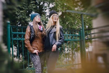 stylishly: two beautiful girls walk around town fashionably and stylishly dressed Stock Photo