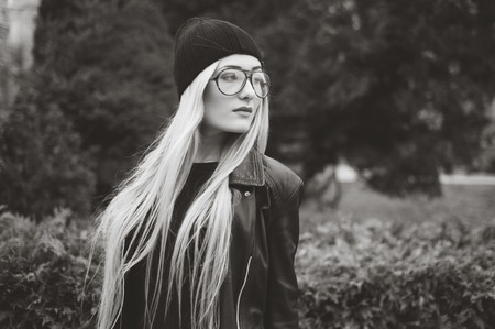 glasses model: beautiful model walks through the city in a beautiful hat and glasses