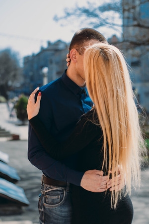 formally: beautiful young couple dressed formally walking down the street Stock Photo